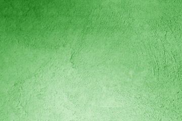 Plaster wall texture in green color.