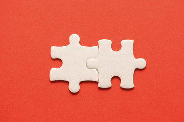 Wall Mural - Two white details of puzzle on red background
