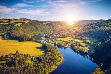 River canyon with dark water and autumn colorful forest. Horseshoe bend, Vltava river, Czech republic. Beautiful landscape with river. Solenice lookout.