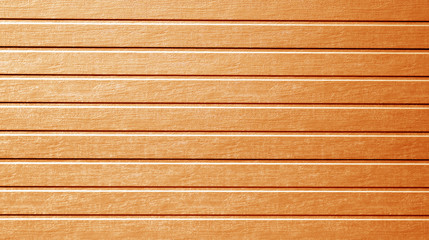 Plastic siding wall texture in orange color.