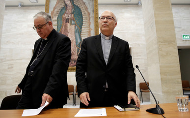 Chilean bishops Luis Fernando Ramos Perez and Juan Ignacio Gonzalez Errazuriz arrive for a news conference after a meeting with Pope Francis at the Vatican