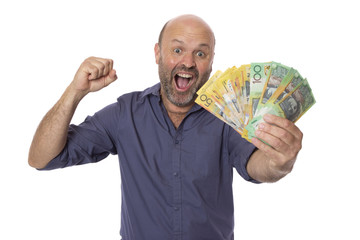 An excited man holding his winnings or earnings.