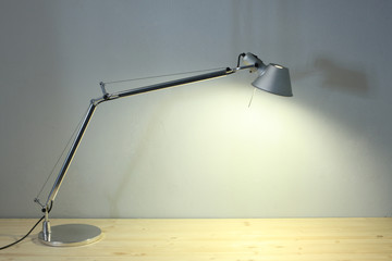 office set: a lamp on a wooden table