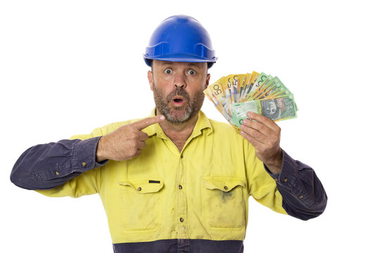 A construction worker awe struck by a windfall of money.