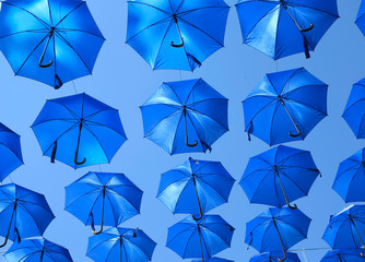 Many blue colorful umbrella street decoration over