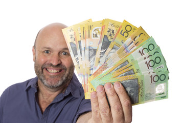 A happy man showing a wad of cash.