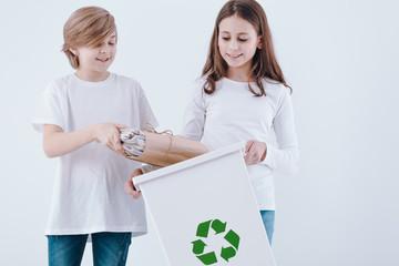 Boy throwing paper into bin