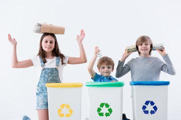 Happy children segregating household waste