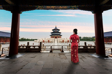 Asian young woman in old traditional Chinese dresses in the Temple of Heaven in Beijing, China.