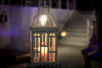 Decorative white lantern with a candle
