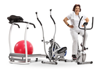 Elderly woman with exercise machines