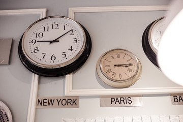 international clock with different time zone for New York and Paris are hang on the wall