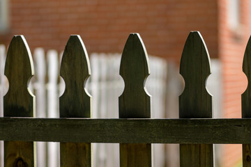 Picket fence with brick house 2