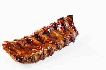 Barbecued sticky spare ribs with copy space