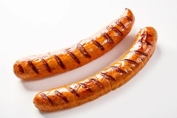 Two seared barbecue sausages with copy space