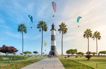 LIMA, PERU: MIRAFLORES LIGHTHOUSE AND PARAGLIDES.