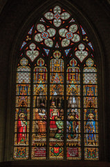 Colorful stained glass window in the St. Michael and St. Gudula Cathedral at Brussels. It is the country's capital and administrative center of the EU. Central Belgium