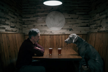 Man and a dog in a bar