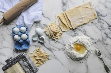 Ingredients and kitchen utensils for homemade pasta (top view)