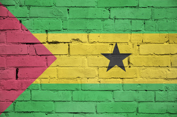 Sao Tome and Principe flag is painted onto an old brick wall
