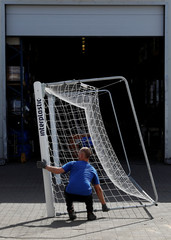Workers hold a goal at Interplastic, a Polish manufacturing company who are supplying the football goalposts for the 2018 World Cup finals in Russia, in Chwaszczyno