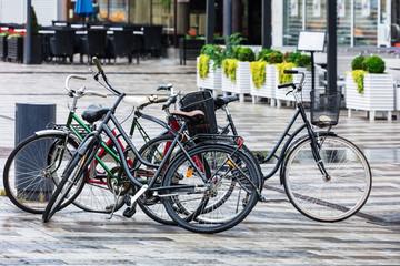 bikes parked on street in rainy weather