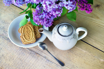 cookie on white dish and English tea