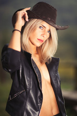 Sexy country girl wearing cowboy hat and leather jacket  - portr