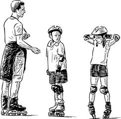 A trainer teaches the kids to skate on rollers