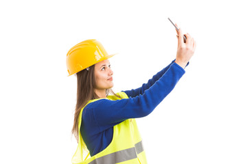 Young attractive female architect taking a selfie.