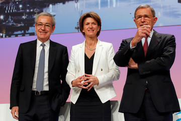Jean-Pierre Clamadieu, newly-appointed Engie board chairman, CEO Isabelle Kocher, and Chairman Gerard Mestrallet pose at the French gas and power group's annual general shareholders meeting in Paris