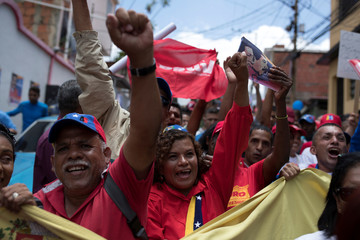 Supporters of Venezuela's President Nicolas Maduro shout slogans during a campaign rally in Caracas