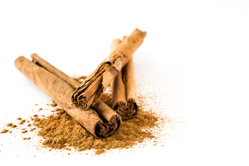 Tuinposter Kruiderij Cinnamon sticks and powder isolated on white background. Copyspace
