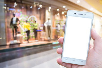 Men use smartphone blurred images in the mall like the background.
