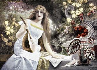 Frau mit Violine auf einer Bank im Garten - 205566379
