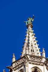 Statue of monk on top of Rathaus, symbol of city, Munich, Germany