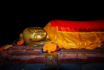 Reclining Buddha image at death place of Gautama Buddha in Parinirvana Stupa, Mahaparinirvana Temple, Kushinagar, Uttar Pradesh, India.
