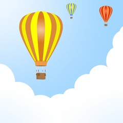 Flying color hot air balloons with hanging wicker basket with background weight with white and blue clouds