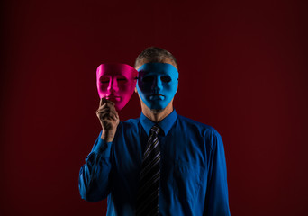 shadow portrait of a man in a blue mask