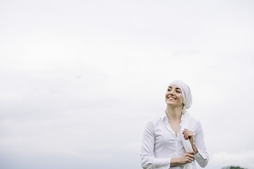 woman with white headscarf, has cancer