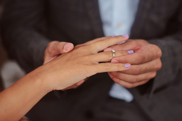 Hands of newlyweds or young lovely couple. Pair of lovers hands close up. Love together concept