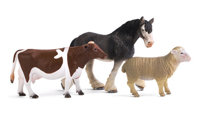 Plastic toy model sheep, cow and horse isolated on white background
