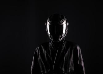 biker in helmet on a black background