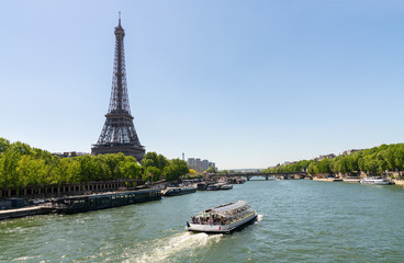 Paris Eiffel Tower and river Seine at summer in Paris, France. Eiffel Tower is one of the most iconic landmarks of Paris. copyspace for your individual text.