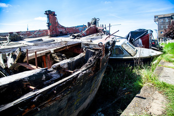 Rotting Wooden Structure of an old cargo  barge on the canal bank