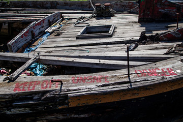 Warning Sign on a Rotting Wooden Structure of an old cargo  barge