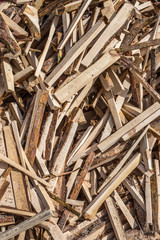 The background of wooden boards is chaotic in the pile.