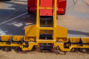 Grabbing grain from asphalt surface by scrapers of conveyor grain loader