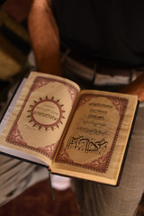 Man holding the Quran