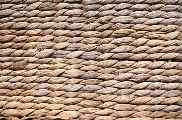 Background texture of beige or straw colored wicker or seagrass